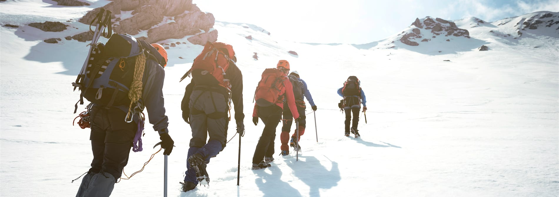 mountaineers climbing a snowy slope